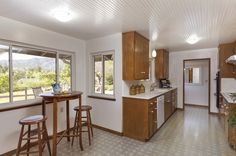 A nook in the kitchen pops out with windows to enjoy more light and views of the property