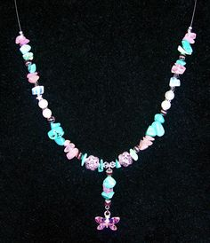 Necklace made as a birthday present for a co-worker... turquoise, rose quartz, moonstone, glass pearls, silver-tone beads and a butterfly.