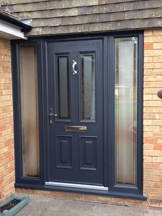 Anthracite grey composite front entrance door with full height glass matching side screens supplied and installed by Unicorn Windows Ltd of Leighton Buzzard, Bedfordshire