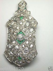 ANTIQUE ART DECO DIAMOND PIN/PENDANT CIRCA ~ 1930's CENTER DIAMOND ~ OLD EUROPEAN CUT DIAMOND  SIZE ~ .58CT COLOR ~ G - H CLARITY ~ VS 1 - VS 2  66 OLD EUROPEAN CUT DIAMONDS ~ 7.62CT  COLOR ~ G - H & O - P  CLARITY ~ SI 2 - SI 3  TOTAL WEIGHT ~ 8.20 CARAT 14 FANCY CUT SYNTHETIC EMERALDS ~ .45CT T.W. METAL ~ PLATINUM (Stamped 10% Irid Plat)