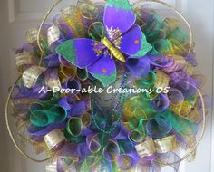 Mardi Gras Spiral Deco Mesh Wreath by ADoorableCreations05 on Etsy https://www.etsy.com/listing/178145680/mardi-gras-spiral-deco-mesh-wreath