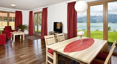 Floor-to-ceiling windows garantee gorgeous lake view @Ferienhaus Schnöllerhof, Rieden, Germany - Booking.com. It looks perfect for family #urlaub