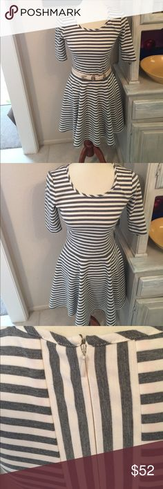 Eliza J Fit and Flare. Hidden zipper in back. Interesting design in back as seen in photo. Belt not included but is for sale separately. Eliza J Dresses