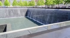 NEW YORK - MAY 27: NYC's 9/11 Memorial at World Trade Center Ground Zero seen on May 27, 2013. The memorial is located at the World Trade Center site, on the former location of the Twin Towers