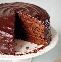 Chocolate Obsession ~ 4 layers of choc sponge cake with dark choc cream truffle filling & choc ganache icing | recipe by Mary Berry via Daily Mail