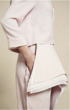 Modern Tailoring with layered fabrics for an unconventional silhouette; contemporary fashion design detail // Steven Tai