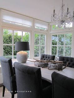 Love the dark chairs for our sunny dining room....lose the lamp and centerpiece though...