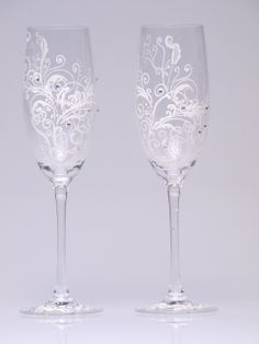 Hand painted Wedding Toasting Flutes Set of 2 Personalized Champagne glasses White ornaments with crystals. $49.00, via Etsy.