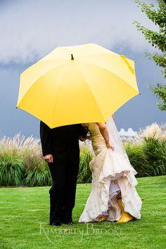 Yellow umbrella on a rainy wedding day | Maryland Wedding Photographer www.KimberlyBrooke.com