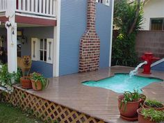 dog bone pool with fire hydrant fountain.