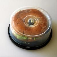 Old cd spindle used as a lunch box for a bagel sandwich.