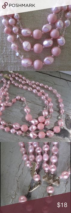Vintage 3 Strand  Beads from Japan These vintage beads from Japan are a beautiful shade of pastel pink.     There are three strands with the longest being 18 inches, and the shortest being 15 inches.     Some of the darker beads are round, while the lighter ones are a baroque shape. The spacers are tiny pink beads.    There are 2 multi-faceted clear beads on each strand.     The closure is a J hook, and is maked 'Japan' Vintage Jewelry Necklaces
