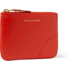 Crafted in Spain from vibrant orange leather, this Comme des Garçons pouch will be easily spotted even in the darkest recesses of your favourite bag. The zipped design makes it ideal for collating loose coins.
