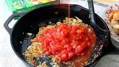 Onion and tomatoes in a skillet
