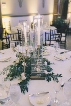 Candlestick Centerpiece – Greenery Wedding These glass hurricane tubes are the perfect add-on to your candlesticks and taper candles. Drop your candlestick holders with taper [. Candlestick Centerpiece, Greenery Centerpiece, Wedding Table Centerpieces, Wedding Flower Arrangements, Wedding Bouquets, Wedding Flowers, Wedding Decorations, Table Decorations, Candlestick Holders