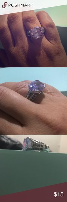 Amethyst ring with gun metal color stones Fashion jewelry. Amethyst stone with gun metal color stones on each side of ring. Jewelry Rings