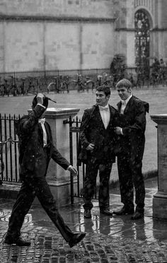 Oxford students in the rain.
