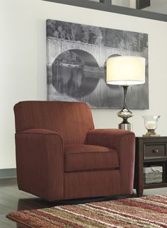 Whether having family time or entertaining friends, this Rustic-hue swivel is a great choice to accent your living room with a pop of color and contemporary style while providing comfortable extra seating. Also the Doralin Swivel is a perfect pair with th Living Room Decor On A Budget, At Home Furniture Store, Swivel Armchair, Nebraska Furniture Mart, Extra Seating, Accent Furniture, Club Chairs, Family Room, Accent Chairs