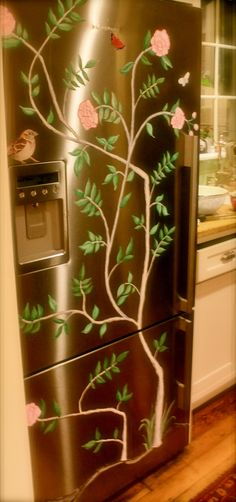 Talk about a cool fridge!  My sister painted her refrigerator to cute it up! Love it!