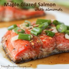 Maple Glazed Salmon with Almonds. Baked salmon portions dressed up with a sweet and spicy maple glaze and topped with crunchy almonds. Salmon Recipes, Meat Recipes, Cooking Recipes, Healthy Recipes, Healthy Foods, Shellfish Recipes, Seafood Recipes, Maple Glazed Salmon, Easy Family Meals