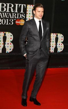 Style for men: Justin Timberlake wore a TOM FORD charcoal grey two piece peak lapel O'Conner suit, white shirt, black knit tie, black and white printed pocket square and black leather shoes to the 2103 BRIT Awards in London on September 20th, 2013.