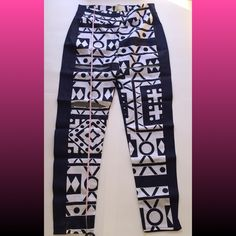 Tribes of Fun High Waisted Pants Super long, tribal print pant with slits down the right leg. These are super oversized and long, will definitely need these altered. I've adjusted the price because I know you'll be paying for alterations. Inseam is 49 inches long  Rue114 Pants Boot Cut & Flare