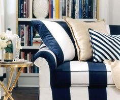 I love this couch for our sitting space by the mirror rooms.  The navy and white stripes are very bold and chic, and neutral pillows are perfect accents to such a loud piece.  Having this couch in our store would be great because it is so unique.