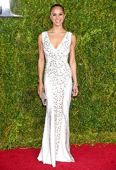 Prima ballerina Misty Copeland presented at the Tonys in a white dress accented with silver beading, plus metallic accessories.