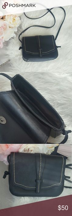 Black Vegan Leather  bag Zipper close on the inside with compartment, including another zipper pocket inside. Also has a zipper pocket in the back of the bag. Magnetic button closure for flap. White front trim on flap only!  Used no more than 3 times, like new! Bag never touched the ground!   Can be used for crossbody or shoulder bag!  Offers Welcomed! 😊 Bags Shoulder Bags