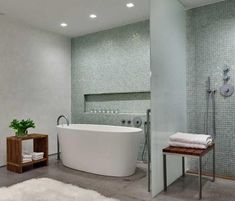 A recessed tile shelf and wall-mounted shower accompany the soaking tub in this bath by Ohlhausen DuBois Architects.