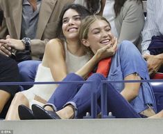 Besties: The models were spotted with big smiles as they cosied up in the stands