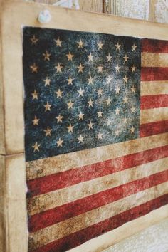 canvas printed and tacked to boards - Fourth of July flag hanging