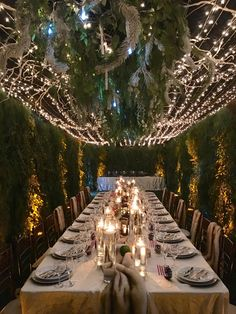 Gorgeous holiday set up.  Green walls, lush over the table florals, floating candles, rustic tea light holders, chiavari chairs and more!  www.exoticgreengarden.com #exoticgreengarden