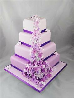 """A """"waterfall"""" of pretty pastel moulded and hand coloured flowers in graduated shades of the same colour – to match the off-set four tier cake which is also graduated in colour top to bottom. Heart Shaped Wedding Cakes, Square Wedding Cakes, Black Wedding Cakes, Square Cakes, Wedding Cakes With Flowers, Pretty Cakes, Beautiful Cakes, Cupcake Cookies, Cupcakes"""