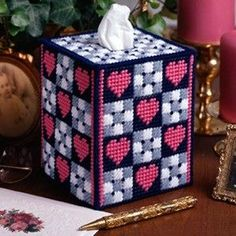 "Checkerboard Hearts Plastic Canvas ePattern - All your guests will want to ""checkout"" this nifty tissue box cover! With its pretty little motifs, you can display it as a special Valentine's Day accent or leave it out all year as an everyday heartwarming touch. The design is stitched using worsted weight yarn and 7 mesh plastic canvas. Number of Designs: 1 tissue box cover Approximate Design Size: 4-3/4""w x 5-3/4""h x 4-3/4""d (fits a 4-1/4""w x 5-1/4""h x 4-1/4""d boutique tissue box)"