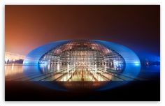 National Centre For The Performing Arts in China  -A performing arts center containing an opera house. The dome is titanium and glass surrounded by an artificial lake and seats 5,452 people. This building is intriguing because it's opaque, flashy, and looks very modern. It is located in Beijing, China. I have NOT been here but would love to someday