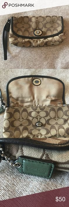 COACH WRISTLET/WALLET Got this as a gift a couple years back. Not really my style anymore. Used lightly. Only thing to be seen wrong is the metal clasp on the front has a little wear on it. Large and has credit card slots. Let me know if you have any questions Coach Bags Clutches & Wristlets