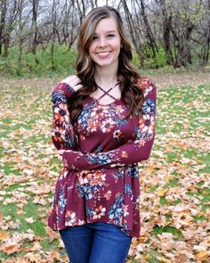 A beautiful wine colored floral long sleeve top with a criss cross V-neck. This top is a must have with its pretty and feminine print! This top is true to size