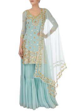 Buy Ice blue embellishment sharara set by Esha Koul at Aza Fashions Beautiful ice blue sharara set. It has embellishment over the kurta and even on the border of dupatta. Kurta has deep U cut with string attached and has embroider sleeve till elbow. Gharara Designs, Kurta Designs, Pakistani Dress Design, Pakistani Outfits, Pakistani Clothing, Indian Wedding Outfits, Indian Outfits, Look Fashion, Indian Fashion