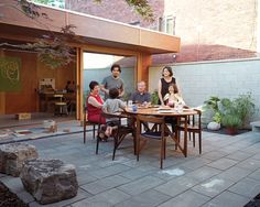 The courtyard in this Toronto home is where the family can catch some sun during the warm summer months, while still maintaning their privacy.