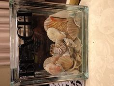 Real cute. We are going to put a family beach picture inside. Great way to use all those shells Isabel brings home.