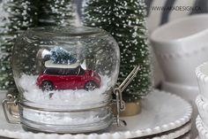 Who else loves to see a Christmas tree tiedto the top of a car in December? On throw pillows,in art printsand more, this iconic scene has regained popularity in Christmas decorating overthe last couple of years.So I thought it may be fun to create a little faux snow globe containing one of our son's old dinky cars carrying a wee little Christmas tree of its own! MichaelsMakers ADA Design