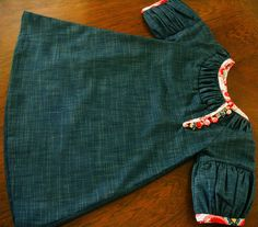 Denim w/ printed bias tape....would look cute w/ the red gingham bias tape I found at Wal-mart