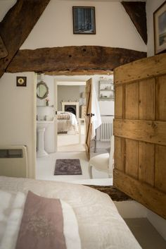 I love absolutely everything about this simple, natural, cozy little cottage! Those raw wood beams. That tranquil bathroom. Storybook English Cottage - Inside the 'Faerie Door' in Wiltshire, England House Styles, Interior Design, House Interior, Cottage Interiors, Cottage Decor, Home, Interior, Fairytale Cottage, Home Decor