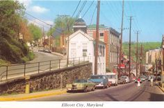 ELLICOTT CITY MARYLAND WINDING MAIN STREET-PATAPSCO RIVER TOWN~POSTCARD 1970s