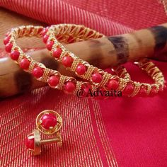 #red #coral #beads #bangle #gold #goldplated #stud #goldfinish #combo #beadwork #beading #beadjewelry #traditional Coral Jewelry, Ethnic Jewelry, Indian Jewelry, Beaded Jewelry, Beaded Bracelets, Gold Bangles Design, Jewelry Design, Beaded Necklace Patterns, Bangle Set