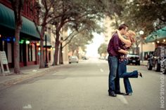 Couple sharing a kiss in Peoples Street during downtown Corpus Christi engagement session Engagement Couple, Engagement Session, Engagement Photos, Photography Sites, Engagement Photography, Downtown Corpus Christi, Engagement Photo Inspiration, Portrait Ideas, Couple Shoot