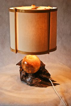 Wooden lamp with hand made shade.