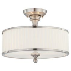 Metal semi-flush mount in brushed nickel with a pleated fabric shade.   Product: Semi-flush mountConstruction Mater...
