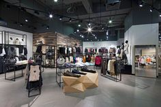 The new Paris store in Santiago, Chile. Using distressed and exposed details, the design team created an urban feel, which is complemented with rich, high-finish materials, such as brass, copper and golden mesh. #retail #interiordesign